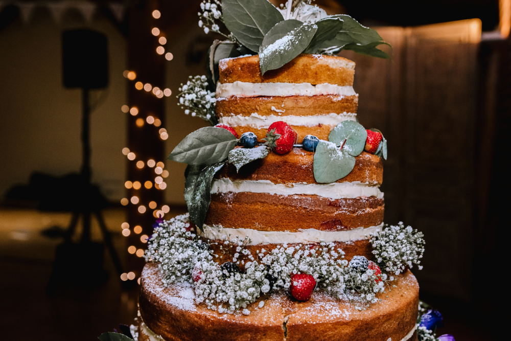 Naked wedding cake foliage and berries