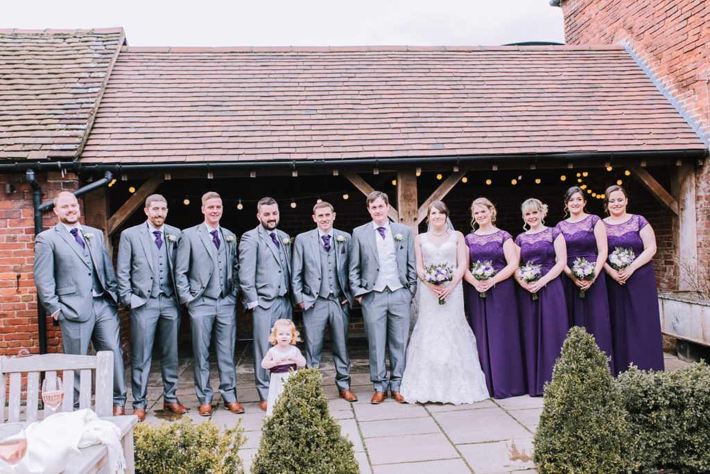 Bride and groom with groomsmen and bridesmaids